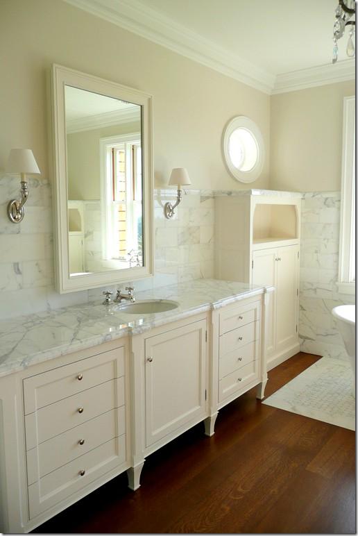 White Carrara Counters and Cream Cabinets